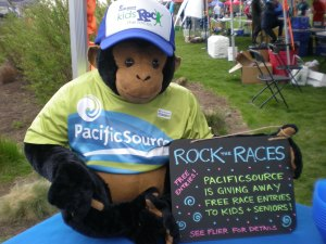 Pete the PacificSource monkey modeling the free hat kids earn after participating in two races.