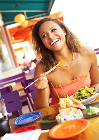 Pretty Mixed Race Woman Enjoying A Meal At A Restaurant
